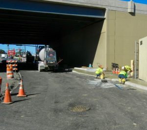 Workers finishing sidewalk on Bleigh Avenue